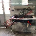 171-27 Revêtement bitumineux contenant de l'amiante sous un évier inox