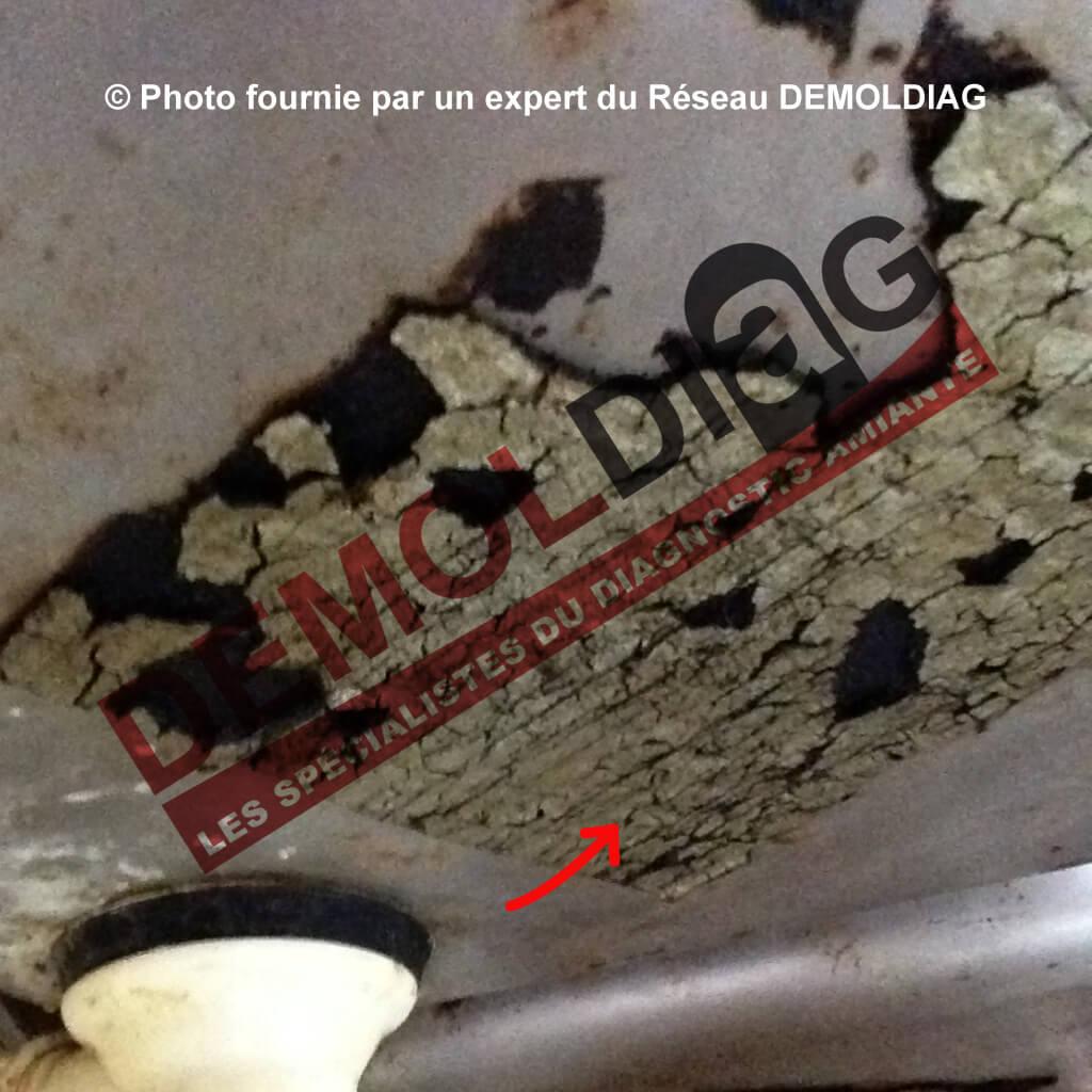 162-02-Plaque anti-vibratile contenant de l'amiante sous évier inox
