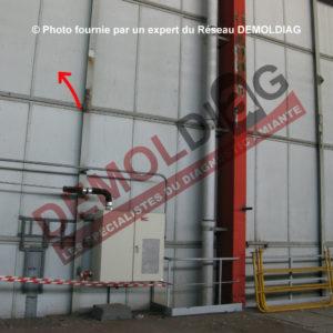 Isolation sous bardage métallique -panneau carton contenant de l'amiante